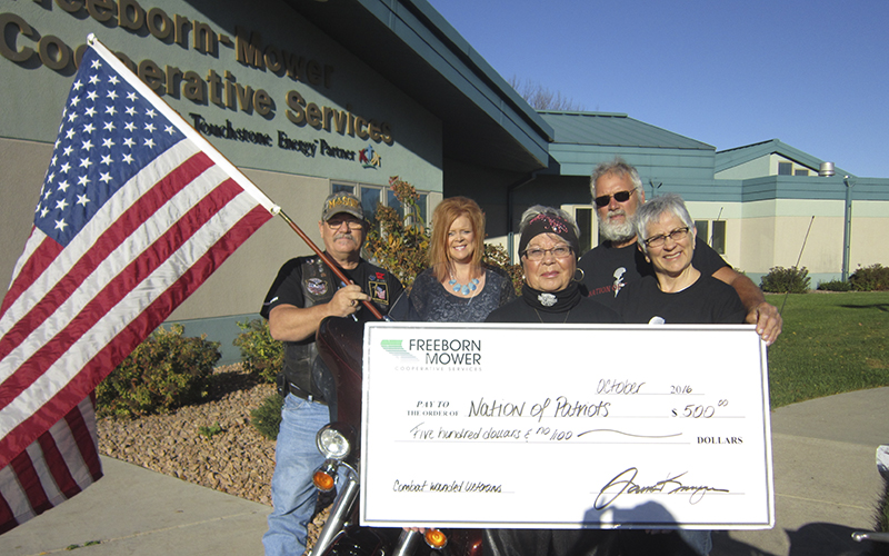 Mark Harig, Judy Renwick, RJ Bergstrom and Dedee Bergstrom, members of the Albert Lea Hog Chapter, recently accepted a donation for the Nation of Patriots from Freeborn Mower Electric Co-op. Dawn Schroeder delivered the check to members outside of the co-op office. Nation of Patriots is committed to serving combat-wounded veterans. -Provided