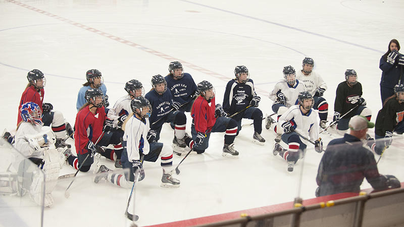 The Albert Lea girls' hockey team takes a knee at the start of practice as head coach Jason Fornwald, not pictured, draws up a drill - Jarrod Peterson/Albert Lea Tribune