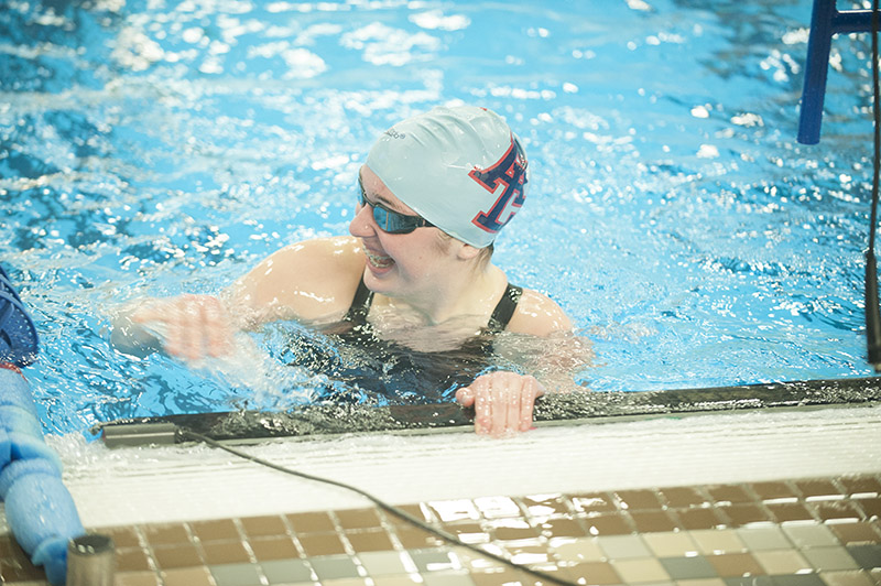 Albert Lea's Emily Taylor reacts with a smile after looking up at the time board and seeing she is headed to the state meet in the 50-yard freestyle event.