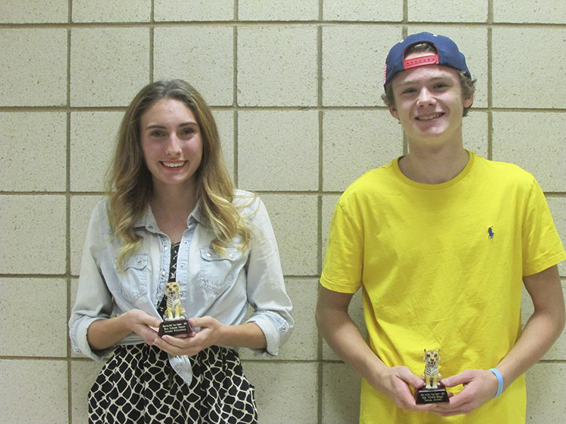 From left, Autumn Muilenburg and Carson Goodell were named Big Nine All-Conference runners for the girls' and boys' team, respectively. Both were also state participants and received team MVP awards.