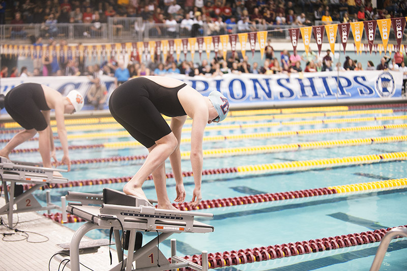 Taylor prepares herself on the starting block before the consolation round of the 100 breaststroke.