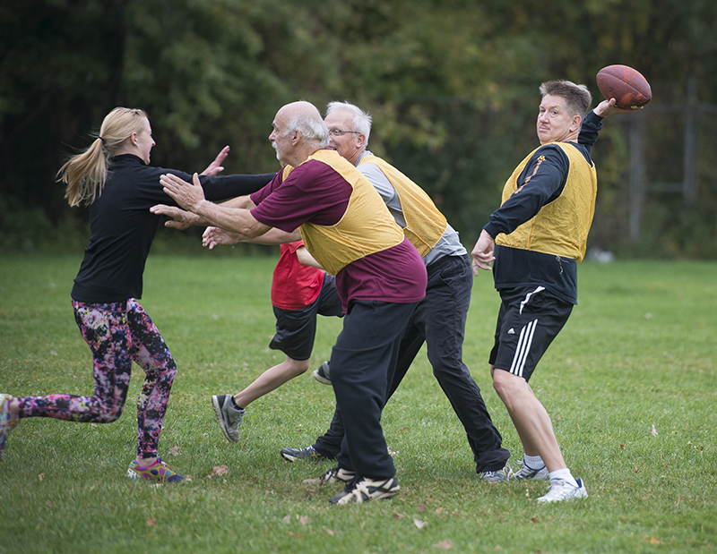 Teammates block for their quarterback, Jim Wendorff, during an October practice game for the upcoming annual Turkey Bowl. - Colleen Harrison/Albert Lea Tribune