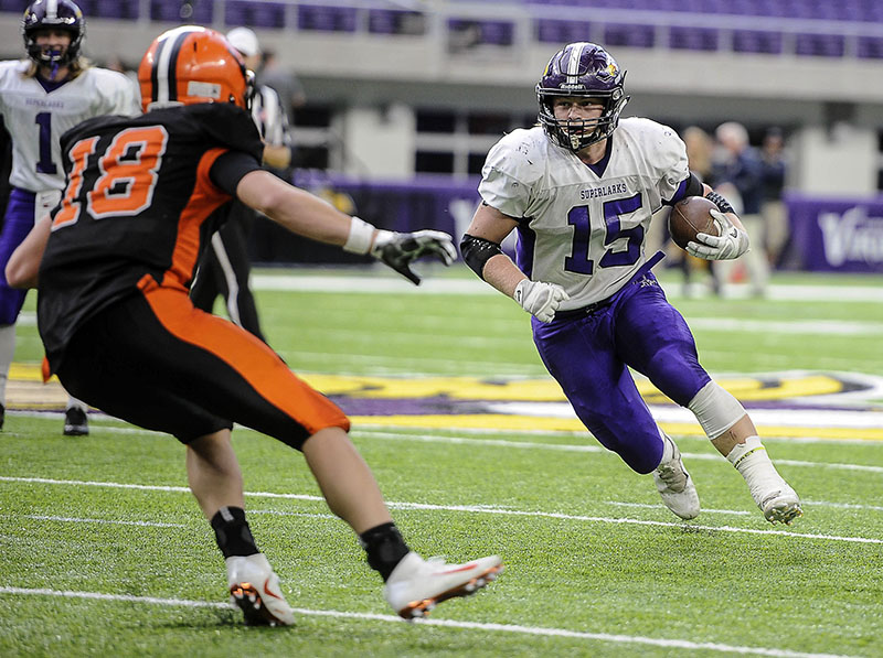 Grand Meadow's Zach Myhre zeros in on Cleveland-Immanuel Lutheran's Carter Kopet on a run in the second quarter of the Minnesota State Nine Man Prep Bowl Friday morning at U.S. Bank Stadium. Eric Johnson/photodesk@austindailyherald.com