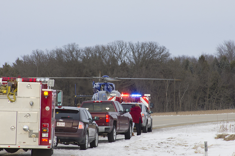 A vehicle was on its side after a crash Friday south of Twin Lakes. - Sam Wilmes/Albert Lea Tribune