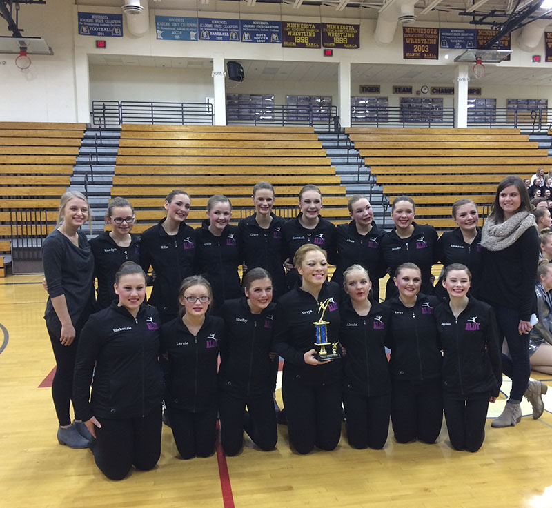 The Albert Lea girls' junior varsity team poses for a photo after beating Austin and Rochester Mayo, and taking home first place in a dance meet Thursday night at Albert Lea High School.