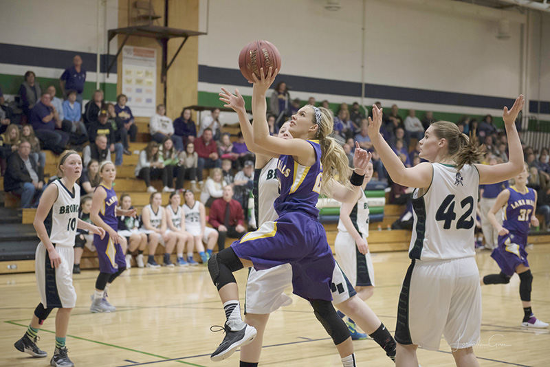 Lake Mills guard Jewell Gasteiger gets past several Belmond-Klemme defenders on her way to the hoop Friday night. She finished the game with six points and three steals. Lory Groe/for the Albert Lea Tribune