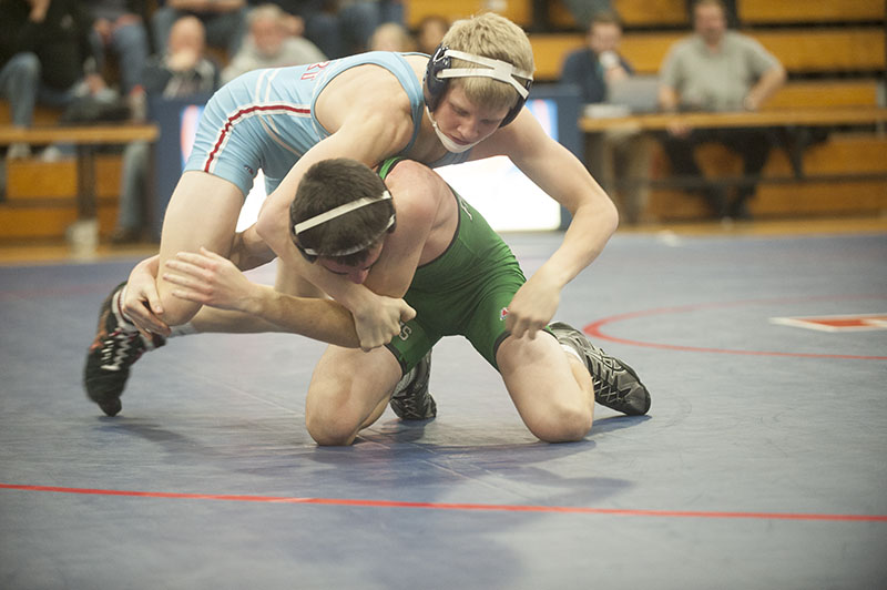 Albert Lea's Jake Johnsrud (top) grapples with Faribault's Bryce Nolen during Thursday's match. Johnsrud won by major decision, 12-3.
