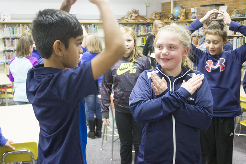 Students Lilly Hyke and Pranav Jha play tic-tac-toe Tuesday in an after-school program at Hawthorne Elementary School. - Sam Wilmes/Albert Lea Tribune