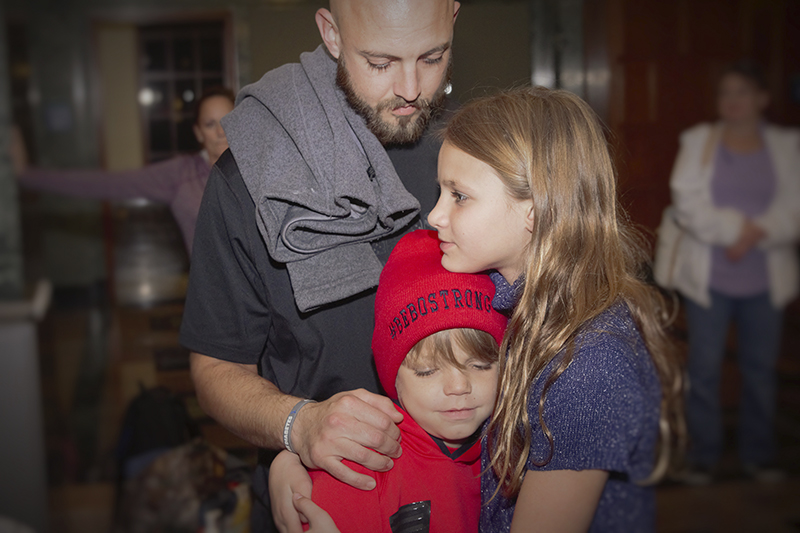 Bebo Getchell embraces his father, Evan, and his older sister, Riley. - Provided