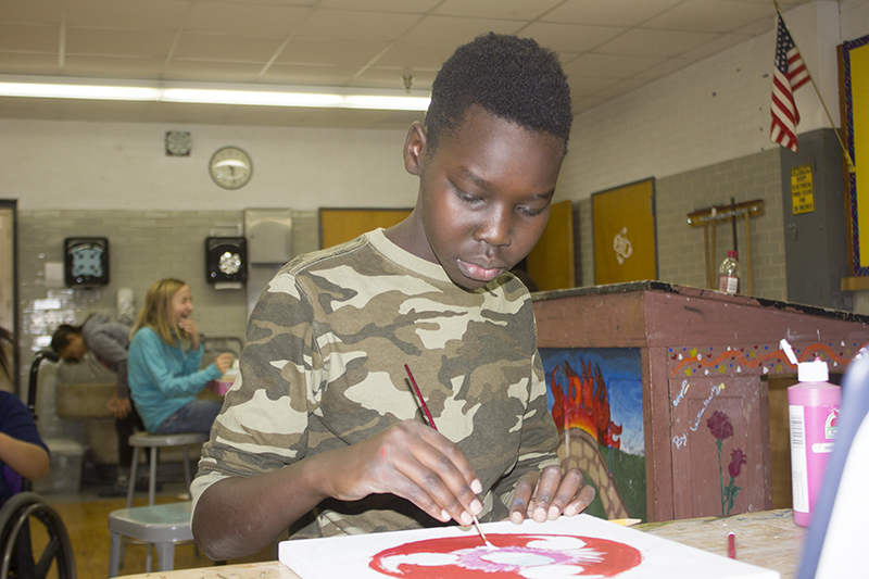 Sixth-grader Patrick Kuey paints Friday for Exploratory Day at Southwest Middle School. — Sam Wilmes/Albert Lea Tribune