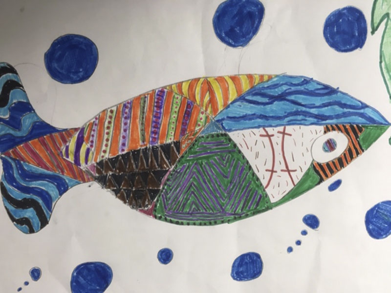 Sibley Elementary School third-grader Jazmine Miclaud created this fish art piece. - Provided