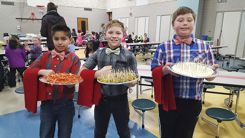 Jesus Guerrero, Triton Cox and Jacob Garrison were student helpers who assisted in serving  appetizers to students before eating with teachers and staff at Halverson Elementary School's fancy lunch gala on Dec. 20. -Provided