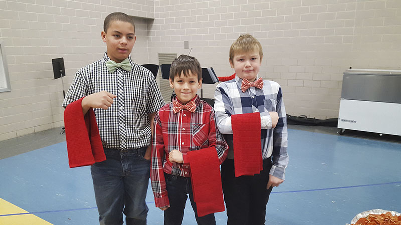 De'Andre Smith, Logan Talamantes and Terrance Bollinger were also student helpers who assisted in serving  appetizers to students before eating with teachers and staff at Halverson Elementary School's fancy lunch gala on Dec. 20.