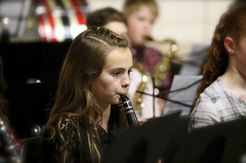 Chloe McCarthy plays clarinet during the Christmas program.  - Ruthanne De Haan/For the Albert Lea Tribune