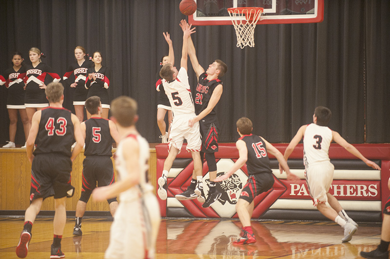 Kenyon-Wanamingo's Jack Beulke goes up for a shot against NRHEG's Oakley Baker in the first half Tuesday night.
