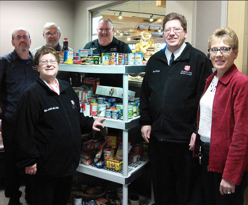 "This holiday season, the employees of Trail's Travel Center collected food donations for the local Salvation Army Food Pantry to help ""Feed the Need"" in our community. Several of the managers from Trail's Travel Center presented representatives of the Salvation Army with all the donation items. - Provided"