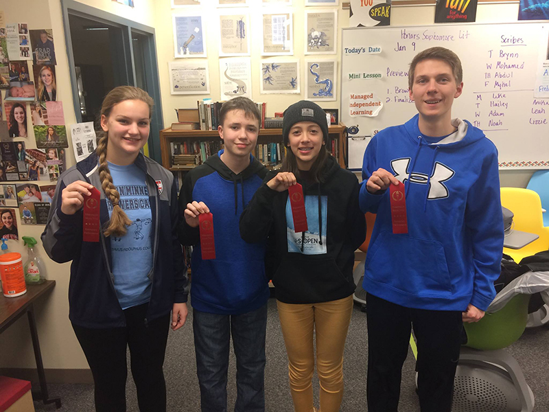 Four members of the mock trial team earned individual performance awards during the Minneapple Mock Trial Invitational in Apple Valley. - Provided