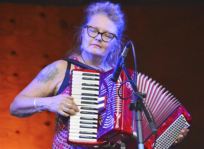 Julie King of Bernie King and the Guilty Pleasures plays accordion and percussion. - Provided