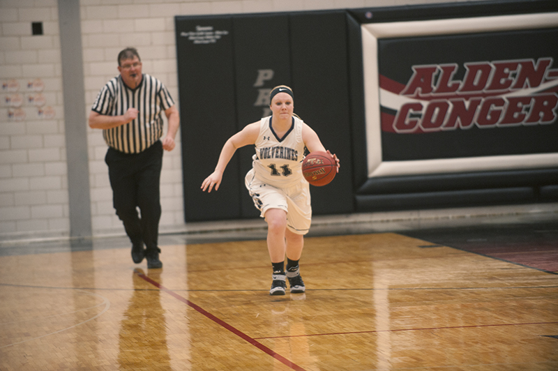 Glenville-Emmons' guard Kayla Gerber brings the ball up the floor during the second half of Monday's game against Alden-Conger. The Knights won the game 56-15.