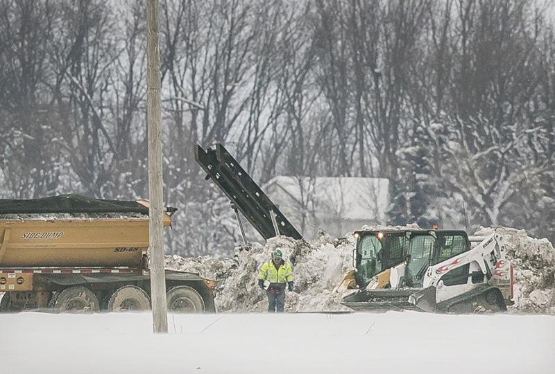 Crews work Thursday afternoon to clean up a diesel fuel spill after a pipeline owned by Magellan Midstream Partners broke at about 8 a.m. Wednesday near Hanlontown, Iowa. Chris Zoeller/Mason City Globe Gazette