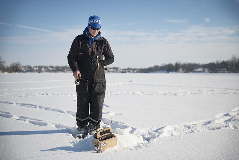 Trevor Herfindahl ice fishes on Fountain Lake on Friday afternoon. - Colleen Harrison/Albert Lea Tribune
