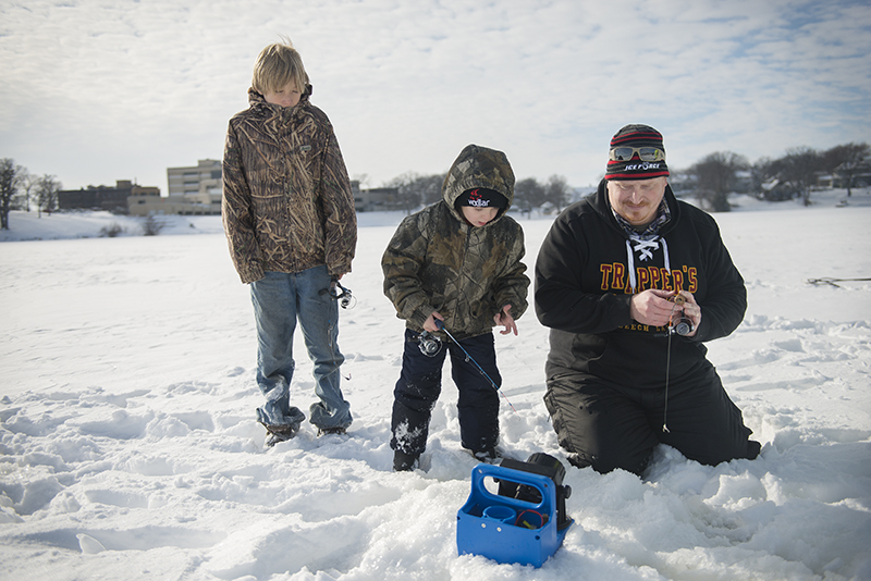 Adam Hamberg fishes with his son, Marcus, and his nephew, Fred Tenneson, on Friday afternoon on Fountain Lake. - Colleen Harrison/Albert Lea Tribune