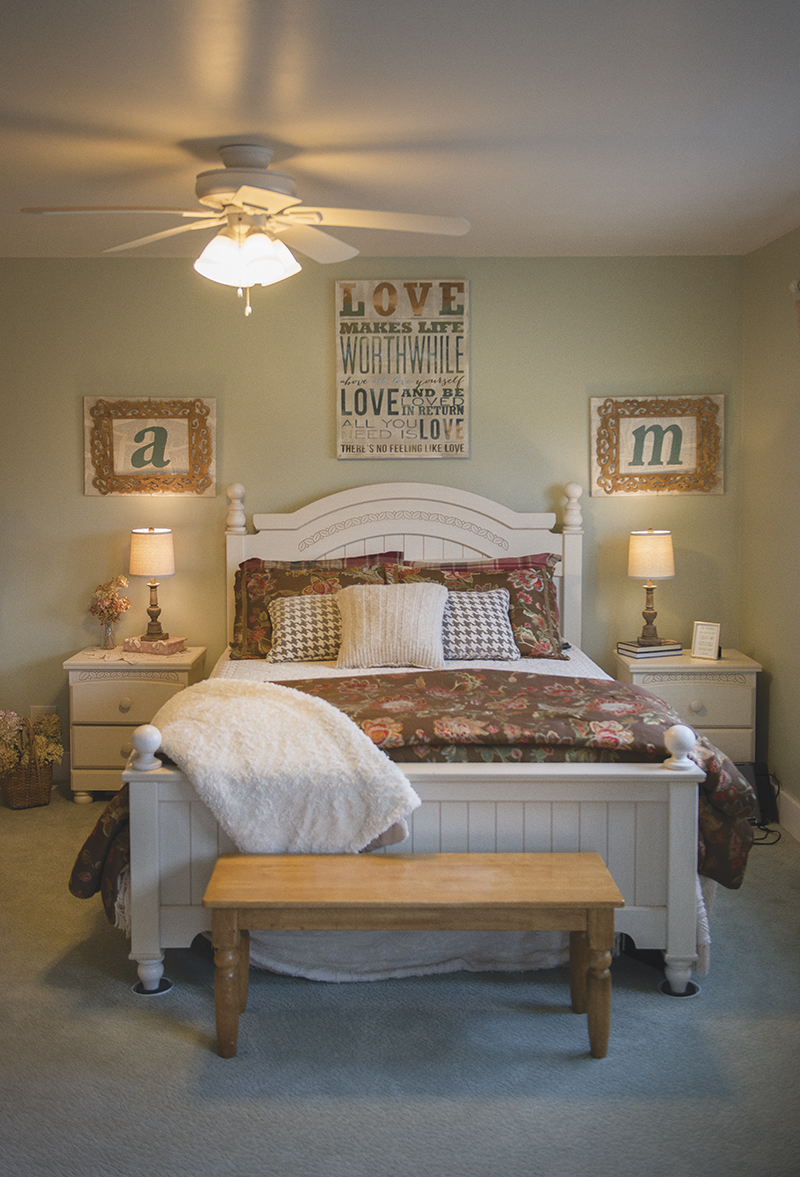 Angela Moller said she likes to change the decor in the couple's bedroom to coincide with the seasons — from different curtains to varying color schemes. - Colleen Harrison/Albert Lea Tribune