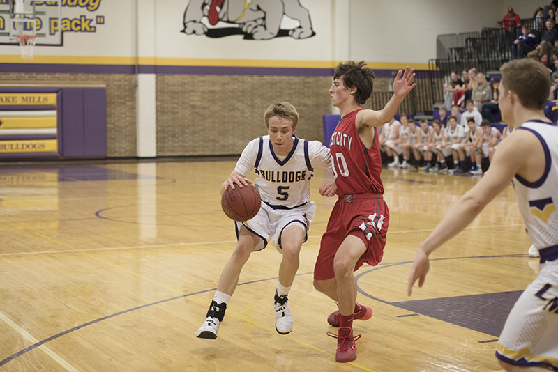 Bulldogs guard Luke Groe looks for a driving lane against Forest City's Ryan Theel in the first half of Monday's game.