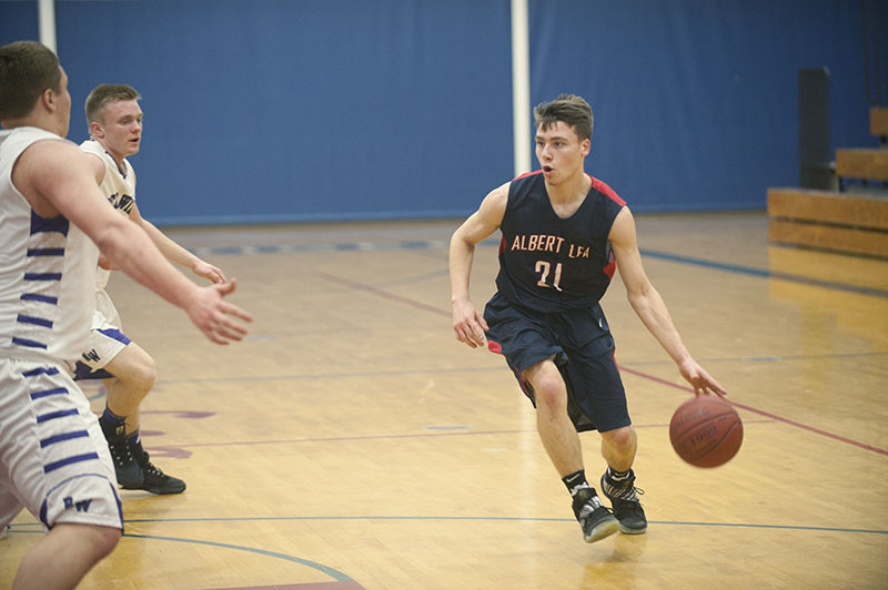 Albert Lea guard Tanner Wichmann looks for a driving lane against Red Wing's defense in the first half Friday night.