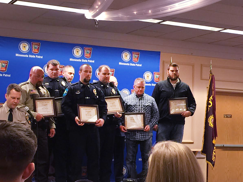 Josh Schipper, far right, was awarded the Meritorious Citizenship Award by the Minnesota State Patrol on Thursday. - Provided