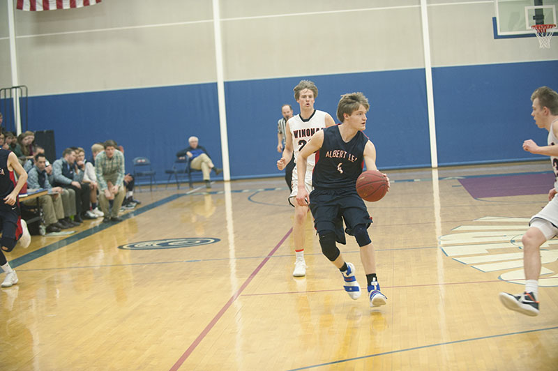 Albert Lea's Jack Buendorf brings the ball up the court in the first during Tuesday's game against Winona.
