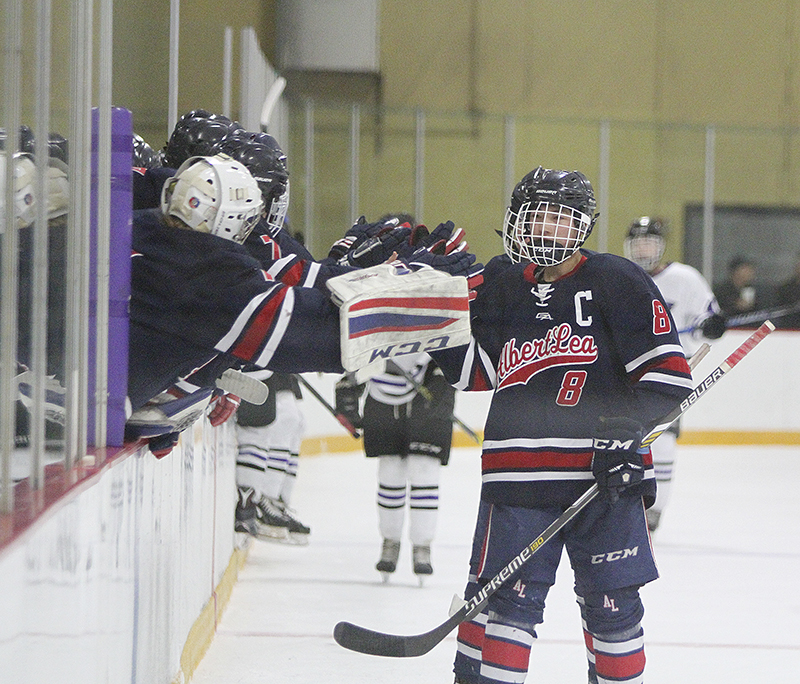 Austin Dulitz and the rest of the Albert Lea boys hockey team celebrate after a first-period goal from Sam Chalmers in Thursday's Section 1A quarterfinal game against Red Wing at Prairie Island Arena.