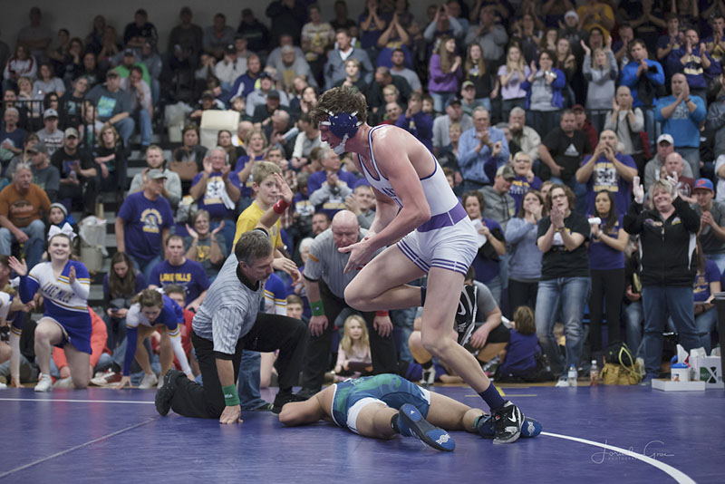 Lake Mills' Gabe Irons gets up after defeating Belmond-Klemme's Tucker Kroeze. This is his first trip to the state tournament.