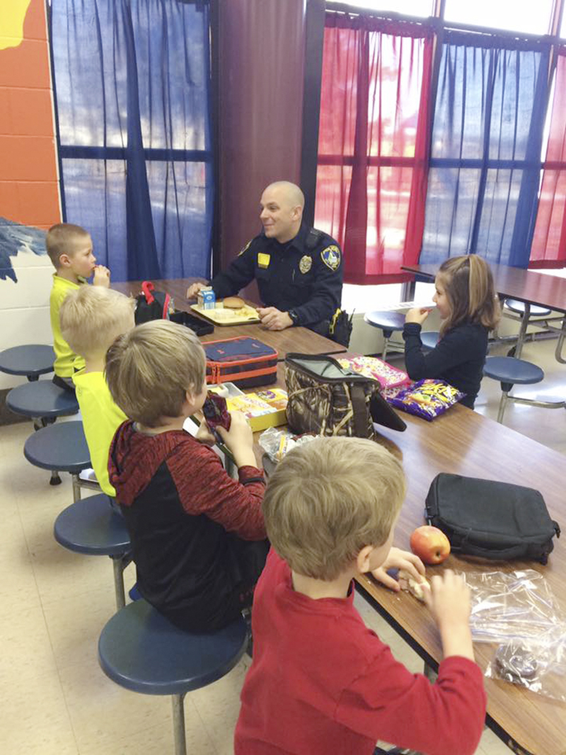Students at Sibley enjoy lunch with an officer from the Albert Lea Police Department. - Provided
